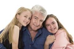 Fader med döttrar Royaltyfria Bilder
