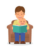 Fader- och barnsammanträde i en fåtölj som läser en bok Läsa barnet för läggdags Arkivfoto