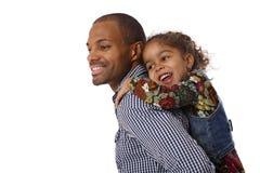 Fader och dotter på ryggen Arkivfoto