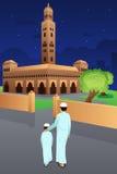 Fader och son som går till moskén royaltyfri illustrationer