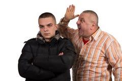Fader och son som har ett argument Arkivbild