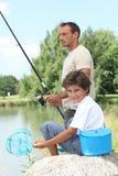 Fader- och sonfiske Royaltyfri Foto