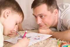 Fader- och sonmålarfärg Arkivfoton