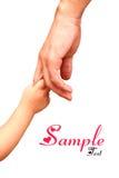Fader som ger handen till ett barn; closeup Royaltyfria Bilder