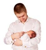 Fadern och nyfött behandla som ett barn Arkivfoton