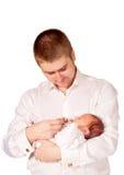 Fadern och nyfött behandla som ett barn. Behandla som ett barn omsorg. Fotografering för Bildbyråer
