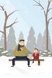 Fadern och sonen parkerar snövinter Arkivfoton