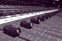 Faders 02. Faders at unity on film mixing console Royalty Free Stock Image