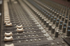 Faders of dusty sound mixer. two faders in focus Royalty Free Stock Images