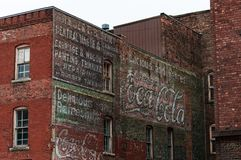 Free Fading Advertisments On The Side Of A Brick Building Burlington Iowa Stock Image - 114946361