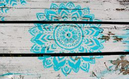 Blue Flower painted on White Faded Picnic Table stock photos
