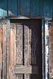 Old wooden door on a vacant house stock images