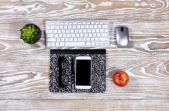 Fading desktop with stationery and technology Royalty Free Stock Photo