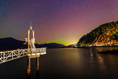 Fading Northern Lights and lookout tower Royalty Free Stock Photography