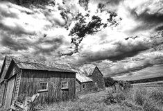 Fading Rural Americana. Beautiful old and  no longer used barns and out buildings near Rennselaerville, New York (Black & White Stock Photography