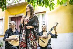 Fado band performing traditional portuguese music in the courtya stock images