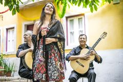 Fado band performing traditional portuguese music in the courtya royalty free stock photography