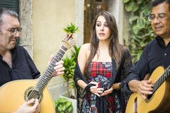 Fado band performing traditional portuguese music on the street royalty free stock photo