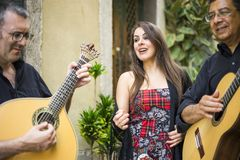 Fado band performing traditional portuguese music on the street royalty free stock image