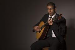Fado musician. With a portuguese guitar, studio royalty free stock image