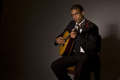 Fado musician. With a portuguese guitar, studio royalty free stock images