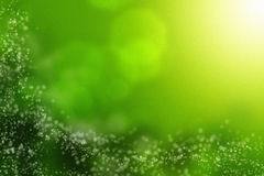 Faerie. Bokeh effect on a green natural abstract background royalty free stock photography