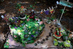 Faerie and Faerie Foxes in Faerie Garden Stock Image