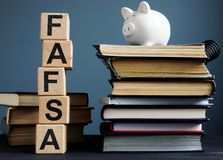 FAFSA Free application for federal student aid. Letters on the cubes royalty free stock photo
