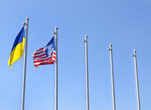 Fag of Ukraine fluttering next to the flag of USA Royalty Free Stock Photo