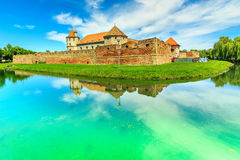 Fagaras fortress and clear lake in Transylvania,Romania,Europe Royalty Free Stock Photo