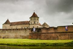 Fagaras Fortress in a cloudy day. Fagaras Fortress- medieval fortress in Brasov, Romania Stock Images