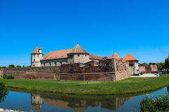 Fagaras Medieval Citadel. A view of the medieval citadel in Fagaras, Romania and its surrounding defensive water ditch royalty free stock image