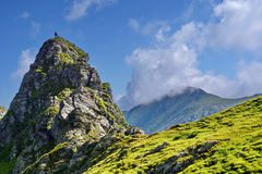 Fagaras Mountains in Romania. Scenic view of Fagaras mountains with blue sky and cloudscape background, Romania royalty free stock photo