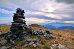 Fagaras Mountains. Stone tower guidance in Fagaras Mountains, Romania Royalty Free Stock Photo