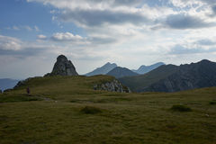 Fagaras mountains view and a hiker stock photography