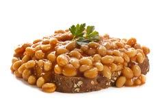 Fagioli cotti su pane tostato Immagine Stock