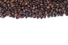 Fagioli di Cofee su bianco Immagini Stock