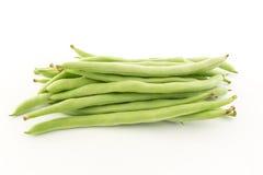 Fagioli verdi su priorità bassa bianca Fotografie Stock Libere da Diritti