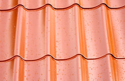 Fagment of red metal roof with many water drops as background Royalty Free Stock Images