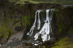 Fagrifoss (Beautifull waterfall) among mossy cliffs in Iceland Stock Photography