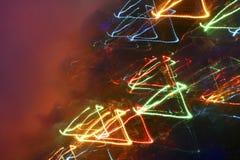 Fahne mit Neondreiecken auf einem dunklen Hintergrund mit Raum für y Lizenzfreie Stockfotografie