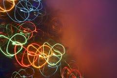 Fahne mit Neonlichtern auf einem dunklen abstrakten Hintergrund Lizenzfreies Stockbild