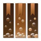 Fahnen mit Aufklebern und Schokoladenbeschaffenheit Stockbild