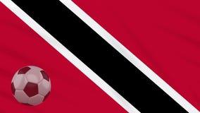 Fahnenschwenkendes Trinidad und Tobago und Fußball dreht sich, Schleife stock video