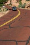 Fahren auf die rote Straße Stockbild