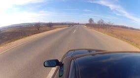 Fahren eines schwarzen Sportwagens stock footage