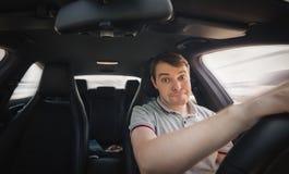 Fahrer in einem Auto Stockfotos