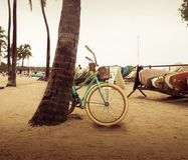 Fahrrad auf dem Strand Stockbild