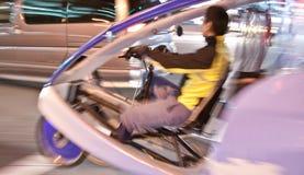 Fahrrad-Auto-Fahrzeug im Bewegungszittern Stockfotografie