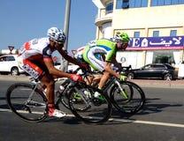 Fahrrad, das Dubai läuft Stockfotografie